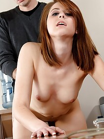 Short-haired redhead takes this guy's meaty cock on a big desk